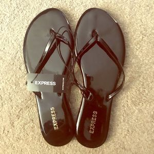 NWT Express Shiny Black Flip Flop Sandals